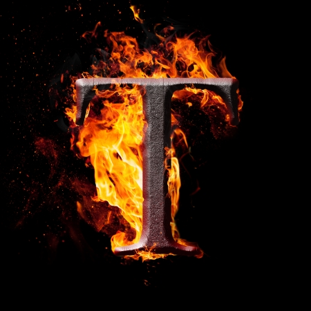 Letters and symbols in fire - Letter T. photo