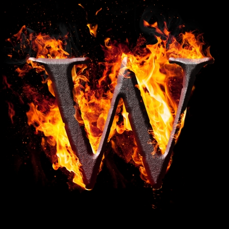 Letters and symbols in fire - Letter W. photo