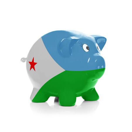 Piggy bank with flag coating over it isolated on white - Djibouti Stock Photo