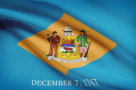 State of Delaware flag blowing in the wind. Part of a series. Фото со стока