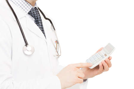 Medical doctor with a calculator in his left hand photo