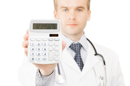 Medical doctor with calculator in his righ hand photo