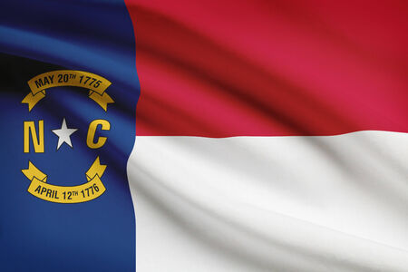 on duty: State of North Carolina flag blowing in the wind. Part of a series.