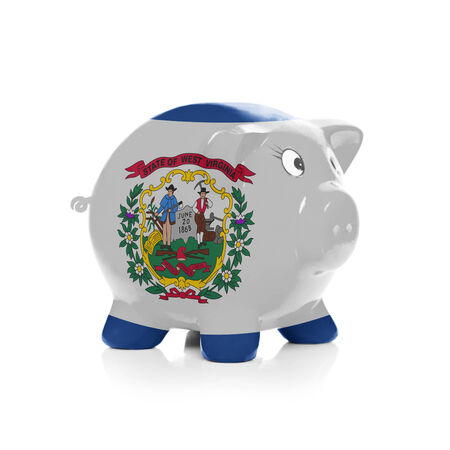 Piggy bank with flag coating over it isolated on white - State of West Virginia photo