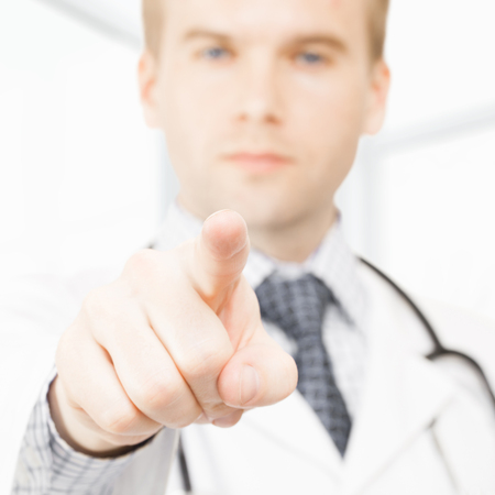 Male doctor pointing his index finger toward viewer - 1 to 1 ratio image