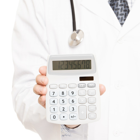supplementary: Medical doctor with a calculator in his right hand showing calculated costs and revenues in physician practice and hospital fees