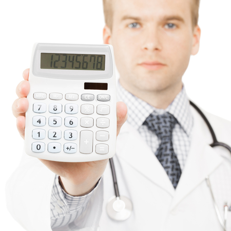 Medical doctor isolated on white with a calculator in his right hand showing calculated costs and revenues in physician practice and hospital fees Stock Photo