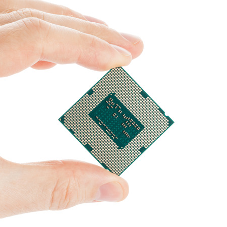 Computer's processor in hand isolated on a white background - 1 to 1 ratio photo