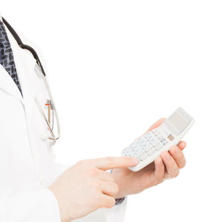 doctor holding money: Medical doctor with a calculator in his left hand - 1 to 1 ratio
