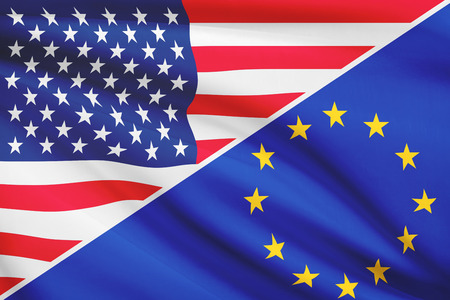 Flags of USA and European Union blowing in the wind. Part of a series.