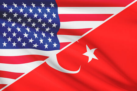 Flags of USA and Turkey blowing in the wind. Part of a series. photo
