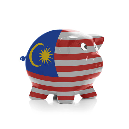 Piggy bank with flag coating over it isolated on white - Malaysia photo