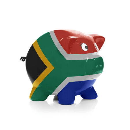 Piggy bank with flag coating over it isolated on white - South Africa photo