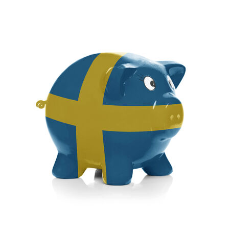 Piggy bank with flag coating over it isolated on white - Sweden