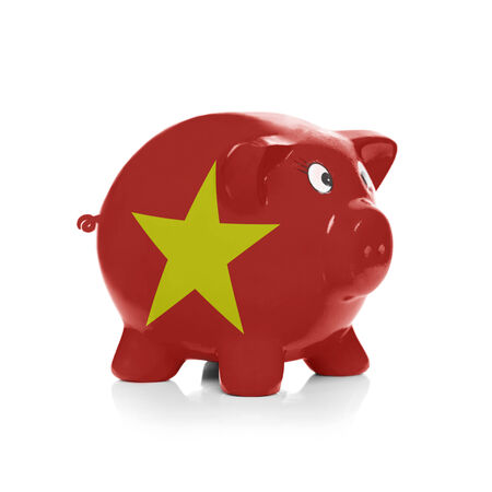 Piggy bank with flag coating over it isolated on white - Vietnam photo