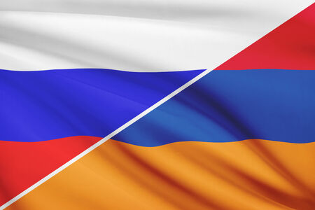 Flag of Russia and Armenia blowing in the wind. Part of a series. photo