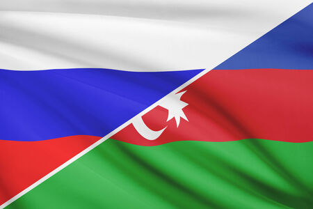 azerbaijanian: Flag of Russia and Azerbaijan blowing in the wind. Part of a series. Stock Photo