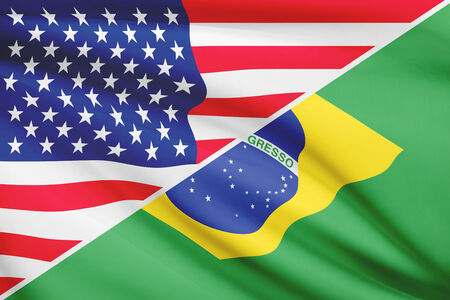 Flags of USA and Brazil blowing in the wind. Part of a series. photo