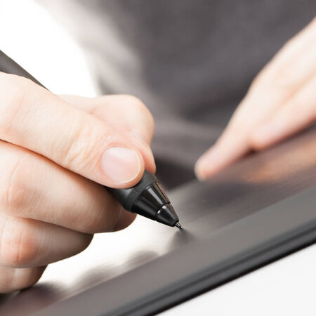 digitized: Artist drawing something on graphic tablet with pen - 1 to 1 ratio