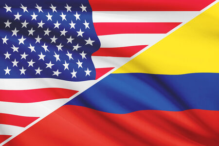 Flags of USA and Republic of Colombia blowing in the wind. Part of a series. photo