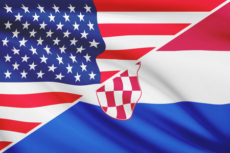 Flags of USA and Republic of Croatia blowing in the wind. Part of a series. photo