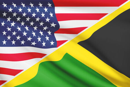 commonwealth: Flags of USA and Commonwealth of Jamaica blowing in the wind. Part of a series. Stock Photo