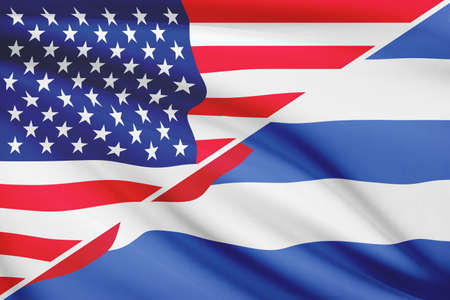 Flags of USA and Republic of Cuba blowing in the wind. Part of a series. photo
