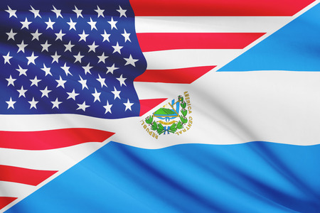 Flags of USA and Republic of El Salvador blowing in the wind. Part of a series. Stock Photo
