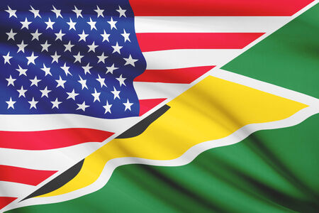 co operative: Flags of USA and Co-operative Republic of Guyana blowing in the wind. Part of a series. Stock Photo