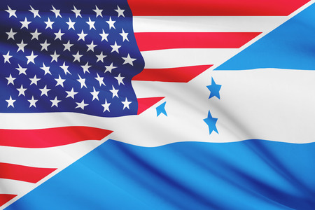 Flags of USA and Republic of Honduras blowing in the wind. Part of a series. photo