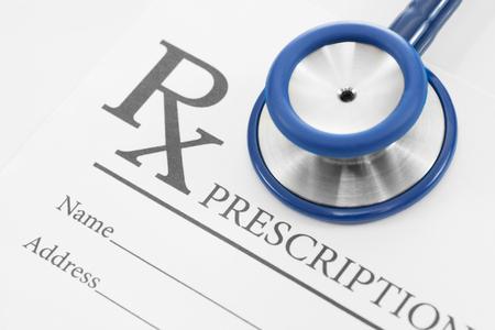 Stethoscope over blank medical prescription form photo
