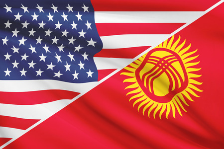 kyrgyz republic: Flags of USA and Kyrgyz Republic blowing in the wind. Part of a series.