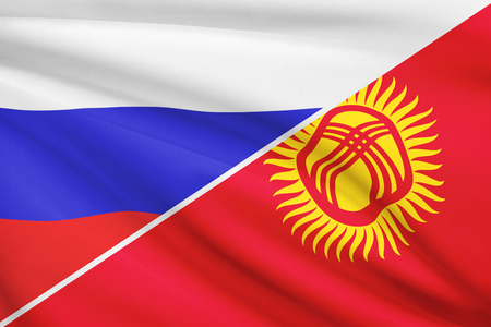kyrgyz republic: Flags of Russia and Kyrgyz Republic blowing in the wind. Part of a series.