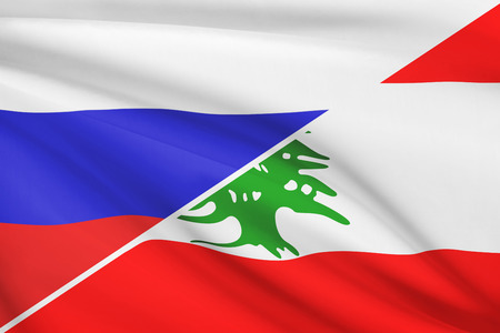 Flags of Russia and Republic of Lebanon blowing in the wind. Part of a series. photo