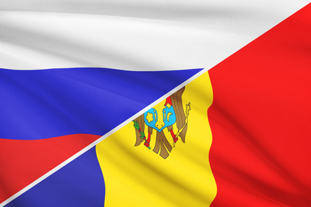 Flags of Russia and Republic of Moldova blowing in the wind. Part of a series. photo