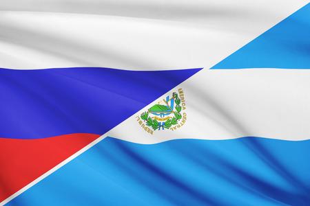 el salvadoran: Flags of Russia and Republic of El Salvador blowing in the wind. Part of a series.