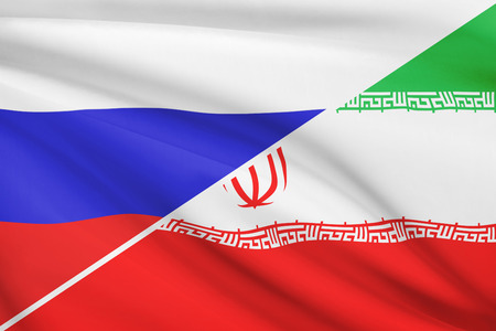 Flags of Russia and Islamic Republic of Iran blowing in the wind. Part of a series. Stock Photo