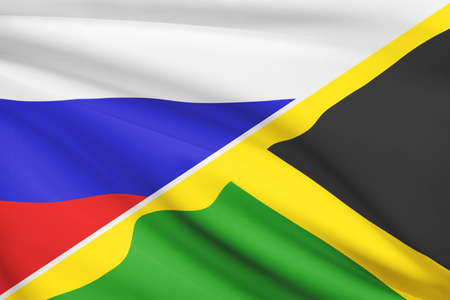 Flags of Russia and Commonwealth of Jamaica blowing in the wind. Part of a series.