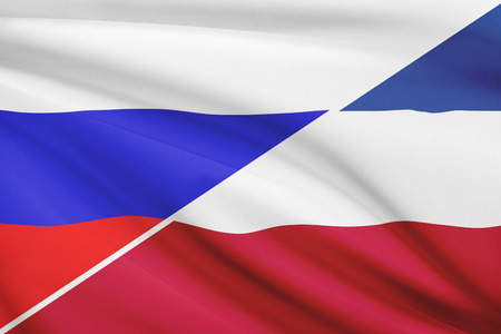 yugoslavia federal republic: Flags of Russia and Socialist Federal Republic of Yugoslavia blowing in the wind. Part of a series. Stock Photo