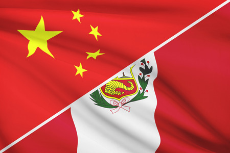 Flags of China and Republic of Peru blowing in the wind. Part of a series. photo