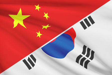 holiday profits: Flags of China and Republic of Korea blowing in the wind (South Korea). Part of a series.