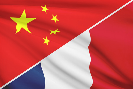 holiday profits: Flags of China and French Republic blowing in the wind. Part of a series. Stock Photo
