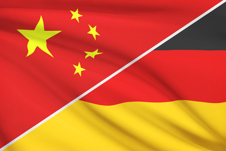 Flags of China and Federal Republic of Germany blowing in the wind. Part of a series.