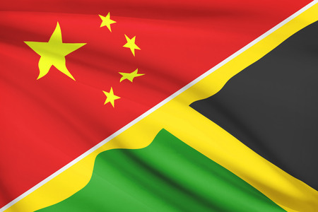 Flags of China and Commonwealth of Jamaica blowing in the wind. Part of a series.