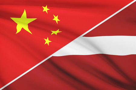 consulate: Flags of China and Republic of Latvia blowing in the wind. Part of a series.