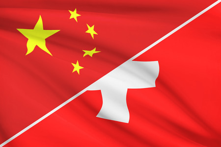 confederation: Flags of China and Swiss Confederation (Switzerland) blowing in the wind. Part of a series.
