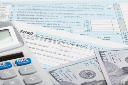 taxable: Tax Form 1040 with calculator and US dollars