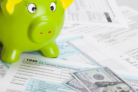 taxable: Tax Form 1040 with green piggy bank