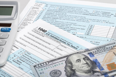 taxable: USA Tax Form 1040 with calculator and 100 US dollar bills