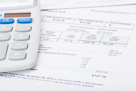 Utility bill and calculator Stockfoto
